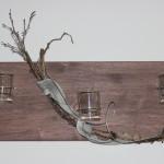 Wandbrett mit Teelichtgläsern